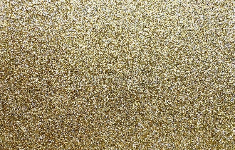 Goldfunkelnhintergrund lizenzfreie stockbilder
