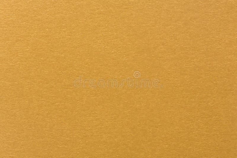 Goldgelbe Luxuspapierbeschaffenheit lizenzfreie stockfotos