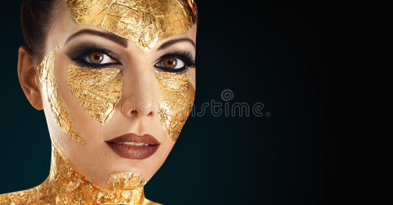 Goldgesichtsmake-up lizenzfreie stockfotografie