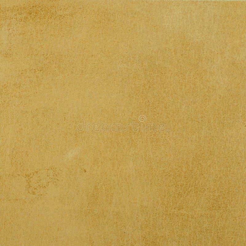 Goldhintergrundbeschaffenheit, glänzendes gelbes Blatt stockfoto