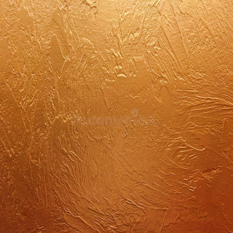 Goldhintergrundpapier, Beschaffenheit ist- alte Weinlese beunruhigte Farbe des gediegenen Golds mit rauer Schalenschmutzfarbe auf stockfoto