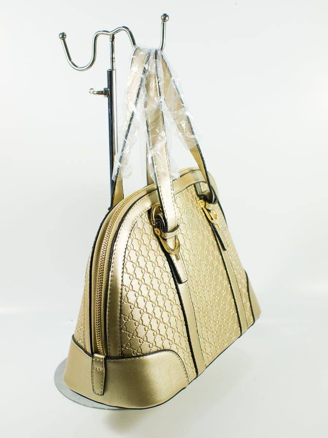 Goldledertasche stockbilder