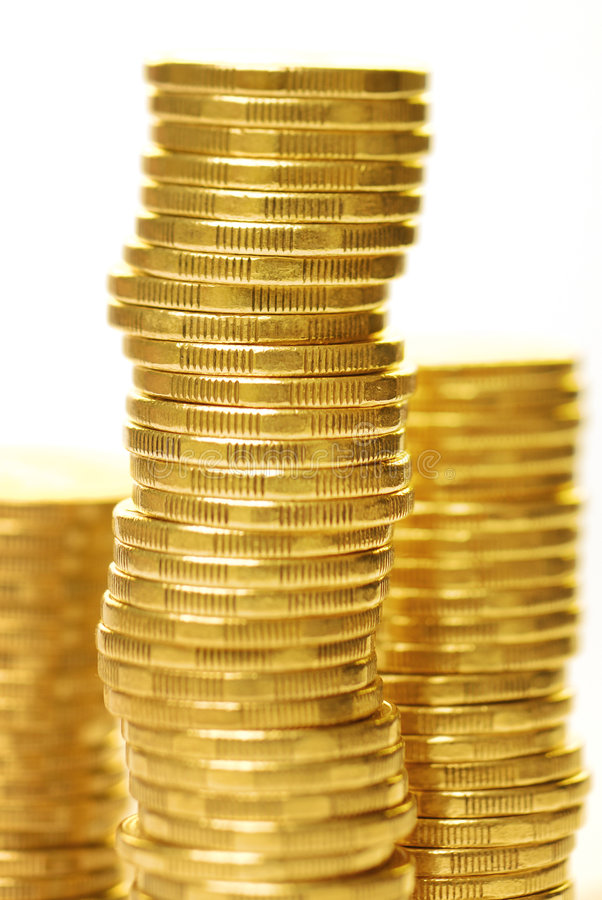 Goldmünze-Stapel stockfotografie