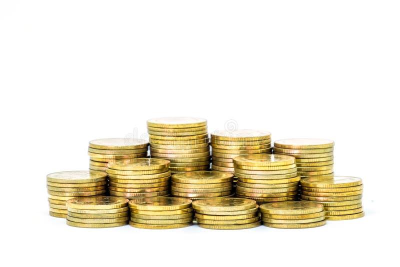 Goldmünzestapel lokalisiert auf weißem Hintergrund stockbilder