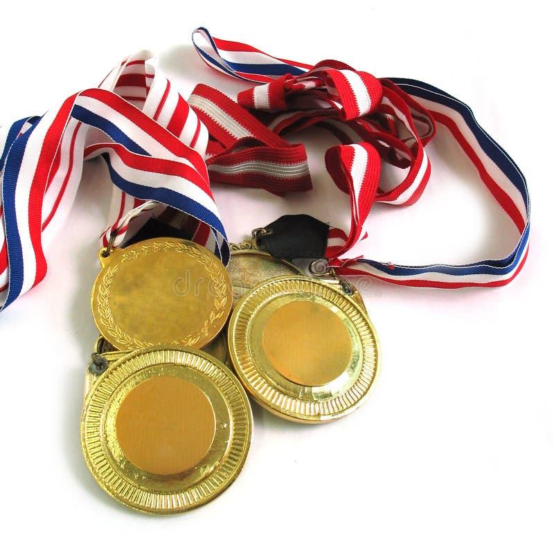 Goldmedaillen stockbild