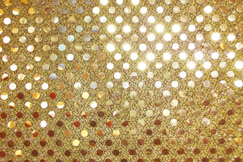 Goldpaillette auf metallischem Gewebe arbeiten Hintergrund/Muster um stockbild
