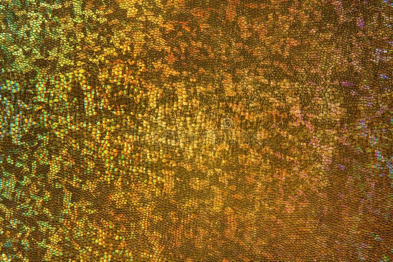 Goldskala-Hintergrund, schuppiges Gewebe-Muster, abstrakte Beschaffenheit stockfotografie