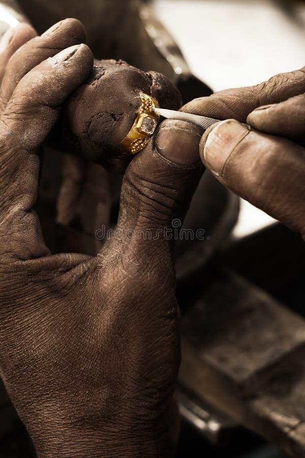 Goldsmith and diamond ring royalty free stock photos