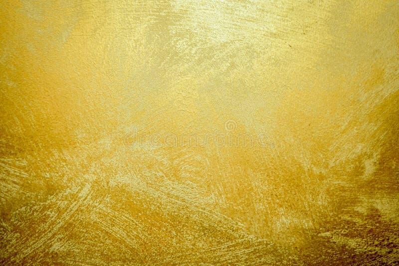 Goldsteinhintergrund und Steigungs-Schatten Schöne helle Messingwand für Papierdekorations-Element Glänzendes gelbes Blatt golden lizenzfreies stockfoto