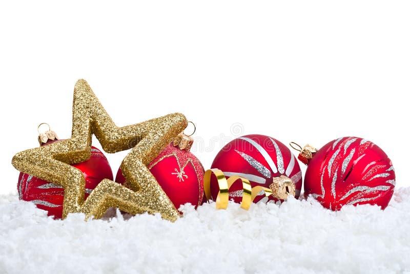 Goldstern und rote Kugelweihnachtsdekoration stockfotografie