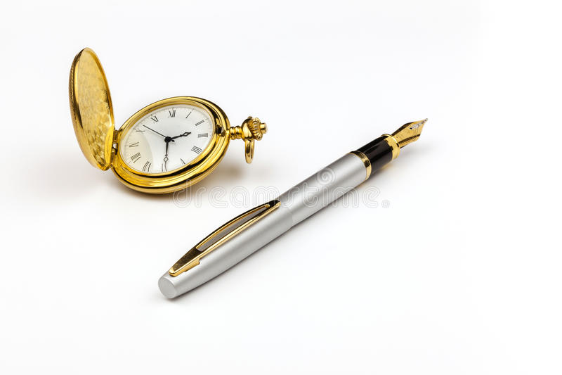Golduhr und -stift stockbild