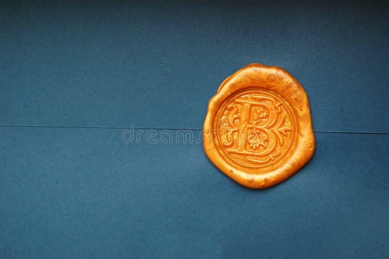 Goldwachs-Umschlag-Dichtung lizenzfreie stockfotos