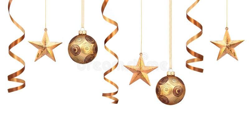 Goldweihnachtsdekorationen stockfotografie