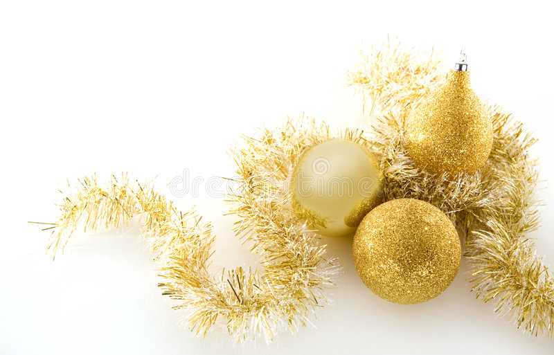 Goldweihnachtsdekorationen stockbilder