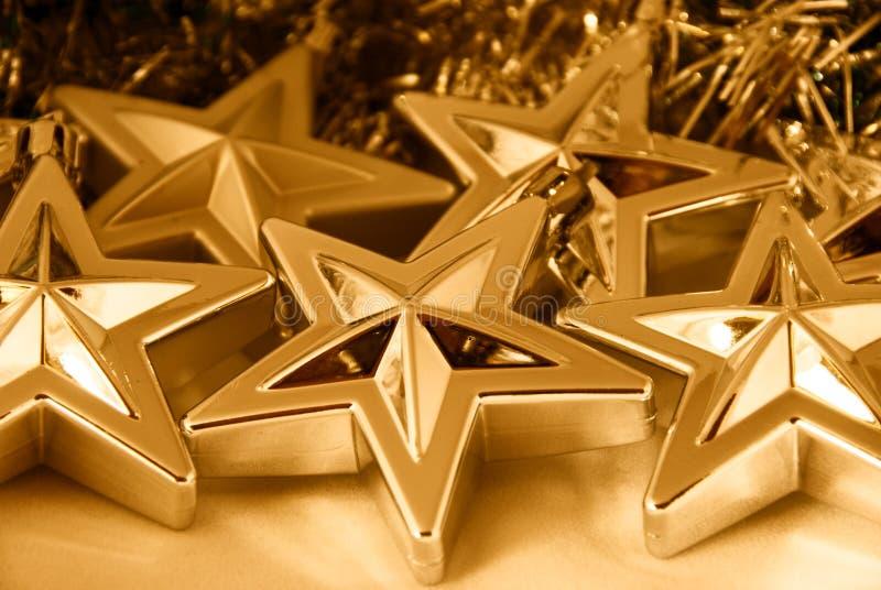 Goldweihnachtssterne lizenzfreie stockfotografie
