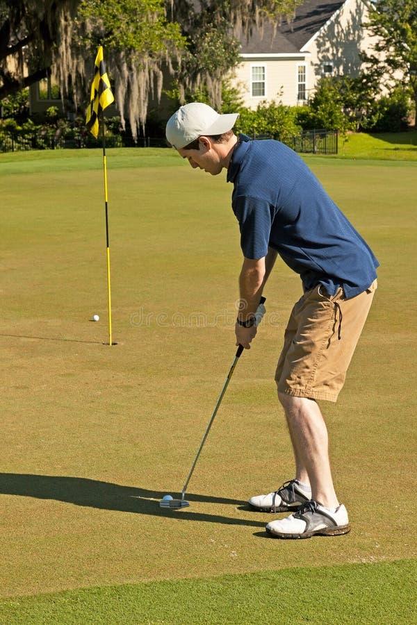 Golf att sätta fotografering för bildbyråer