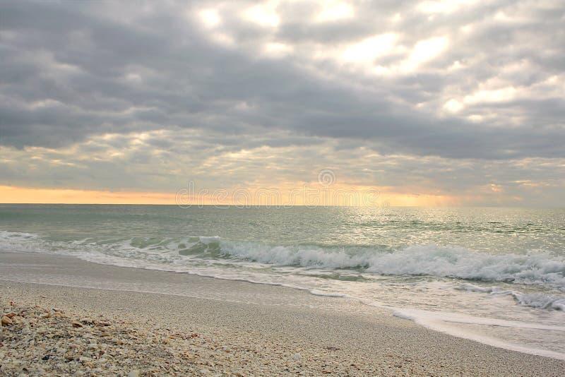 Golf av det Mexico havet på solnedgången arkivbild