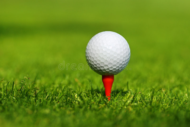 Golf background. Close up of a golf ball on the tee stock photos