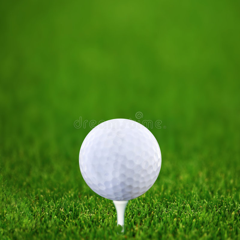 Golf-bal and green golf stock image