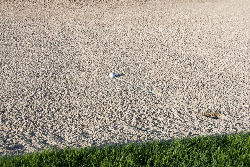 Golf Bal In Sand Trap Stock Image