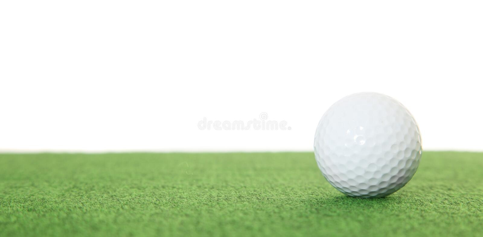 Golf ball. Single golf ball on green. All on white background stock images