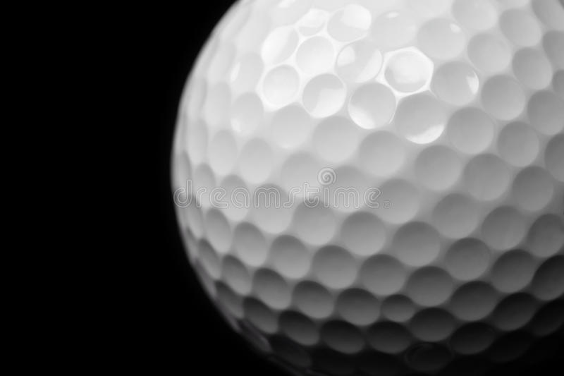 Golf ball on black royalty free stock images