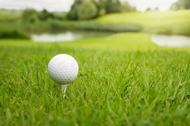 Golf ball at the course royalty free stock photo