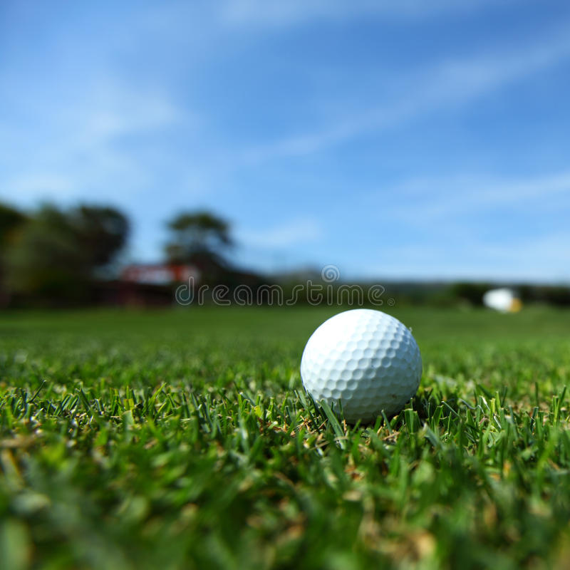 Golf-ball on course royalty free stock images