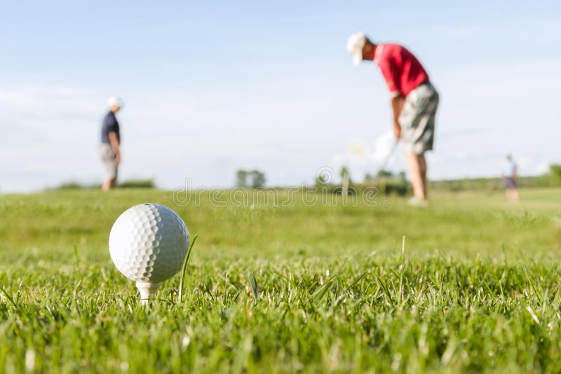 Golf ball on the course royalty free stock photography