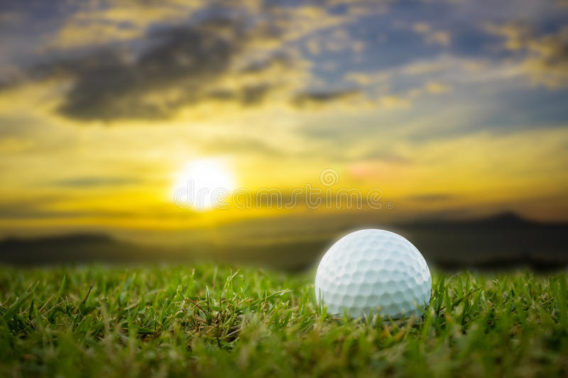 Golf-ball on course sunsets royalty free stock images