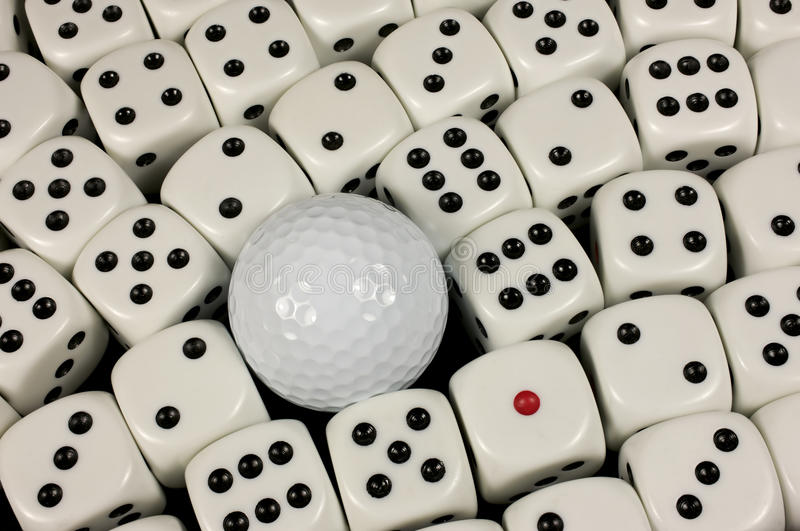 Golf ball dice. Golf ball amongst dice makes for risky shot royalty free stock image