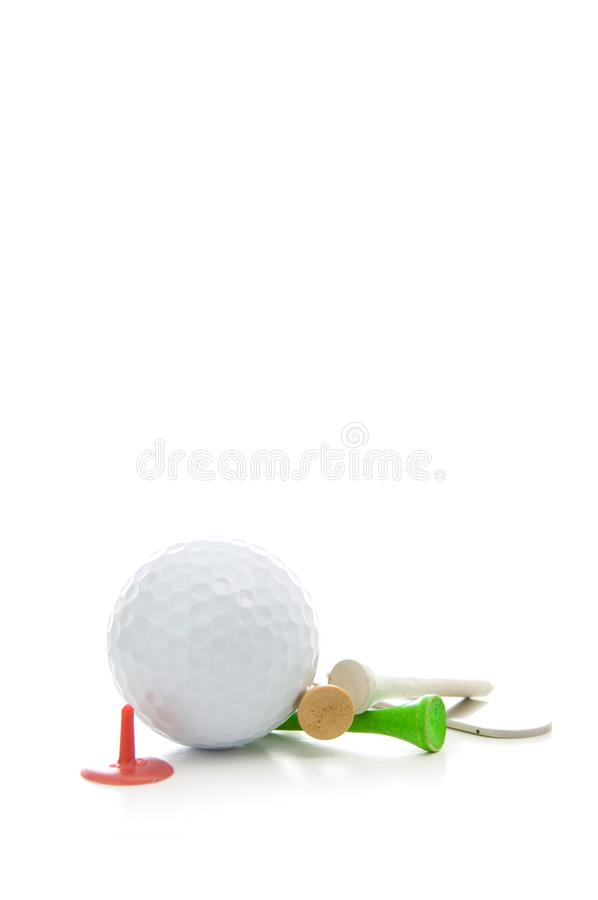 Golf Ball, Divot Repair Tool, Colored Tees and Accessories Isolated on White Background stock photography