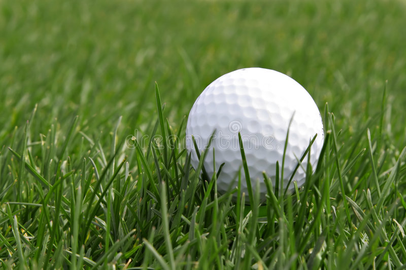 Golf ball in the field stock photos