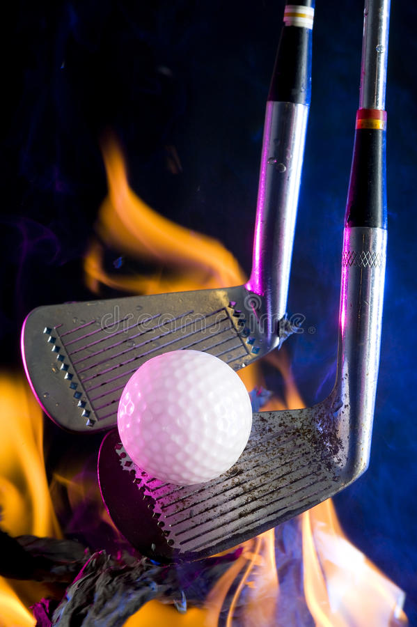 Golf ball and fire royalty free stock image