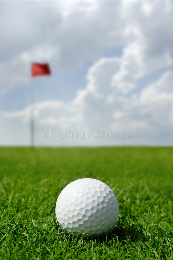 Golf ball and flag stock images