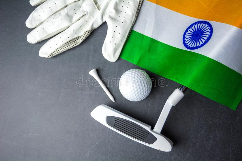 Golf ball with flag of India on wood table royalty free stock image