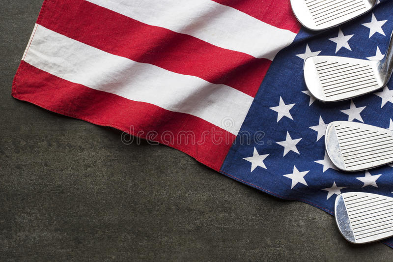 Golf ball with flag of USA on black background stock photo