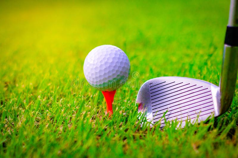 Golf ball and golf clubs on the Course. stock image
