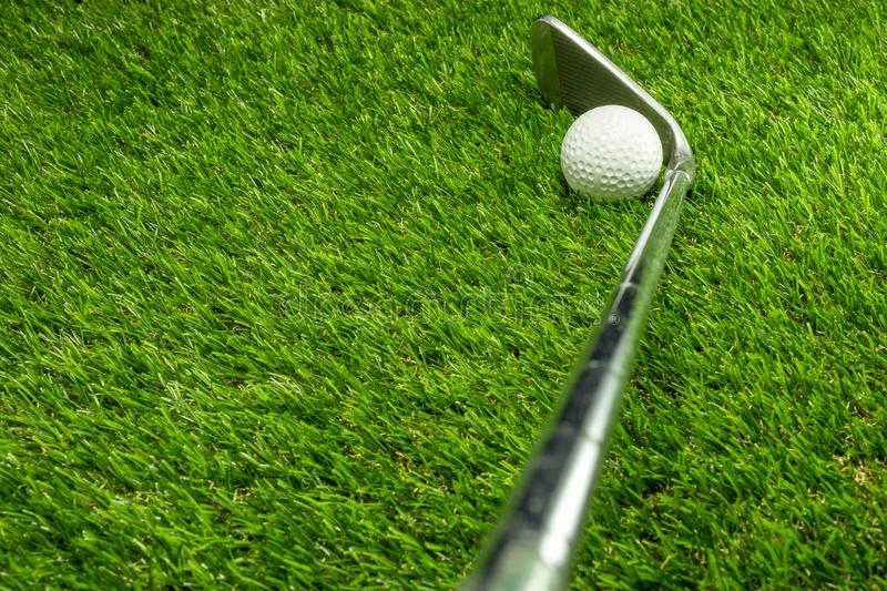 Golf ball and golf club on grass. Golf ball on grass club activity background beautiful close color competition copy course day detail equipment fairway field royalty free stock photography