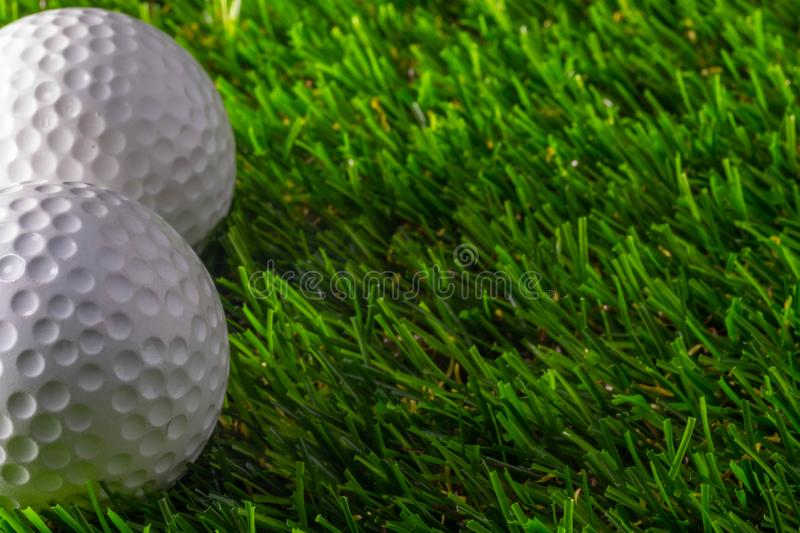 Two golf ball on grass royalty free stock images