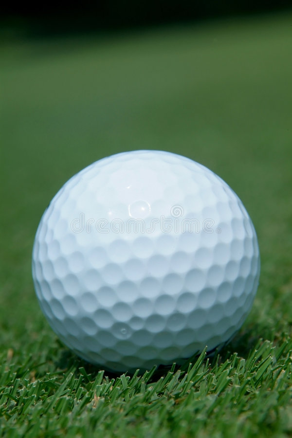 Golf-ball on green. Close-up of golf-ball on green. Shallow depth of field royalty free stock image