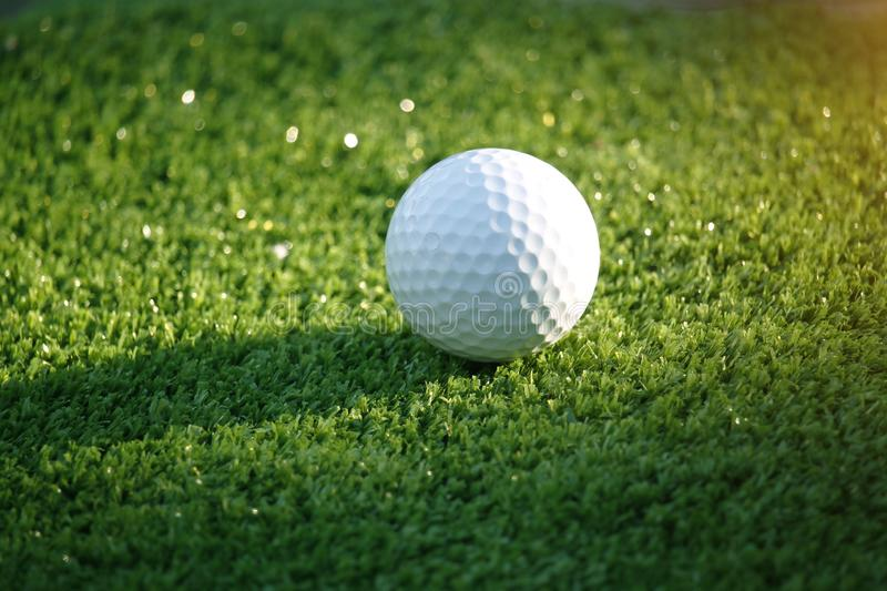 Golf ball on green in beautiful golf course at bokeh background. Golf equipment on green in golf course royalty free stock images