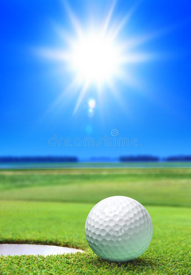 Golf ball on green course royalty free stock image