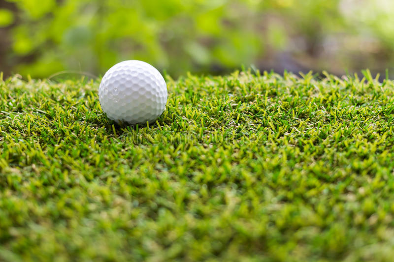 Golf ball on green grass background. Individual sports stock photo