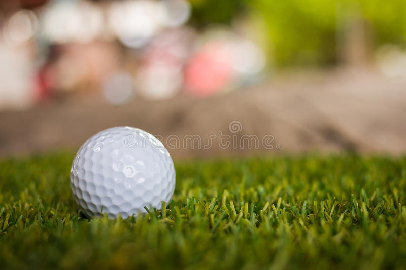 Golf ball on green grass for golfing. Individual sports royalty free stock photo