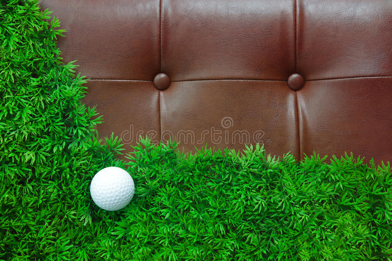 Golf Ball On Green Grass And Luxury Leather Royalty Free Stock Photography