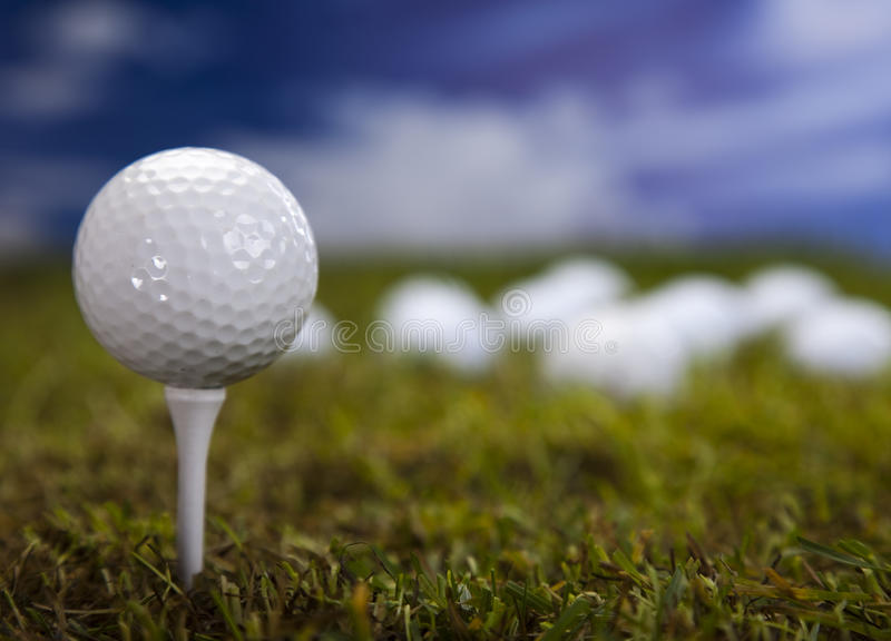 Golf Ball On Green Grass Over A Blue Sky Royalty Free Stock Image