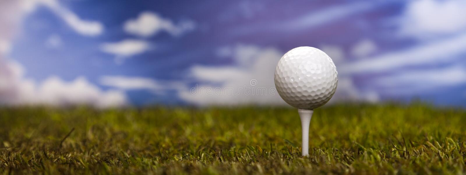 Download Golf Ball On Green Grass Over A Blue Sky Stock Image - Image: 26850305