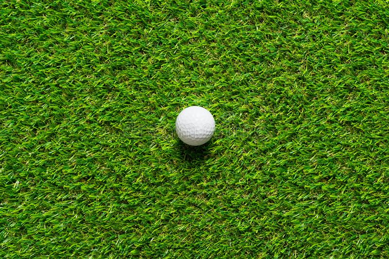 Golf ball on green grass texture of golf course for background. stock photography