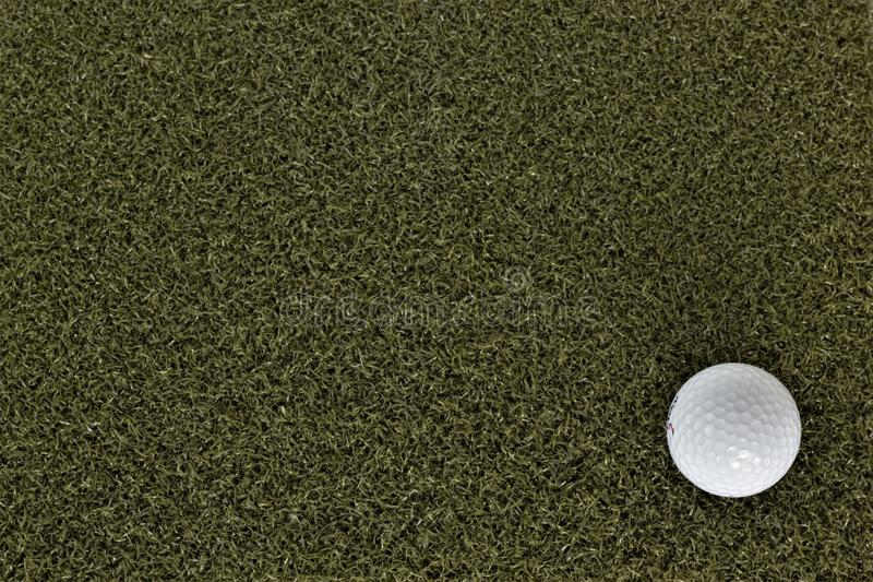 Golf ball on green with negative space. Good for social media posts royalty free stock photo